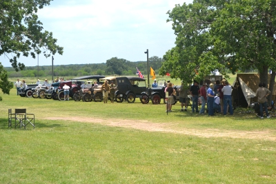 Re-enactor's camp and antique vehicle line