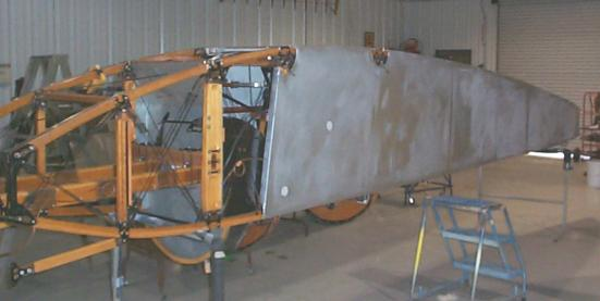Fuselage covered to silver coat