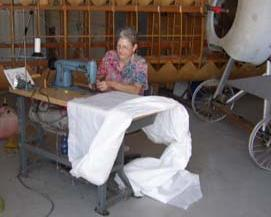 Clara Mae Marcotte sews wing covers