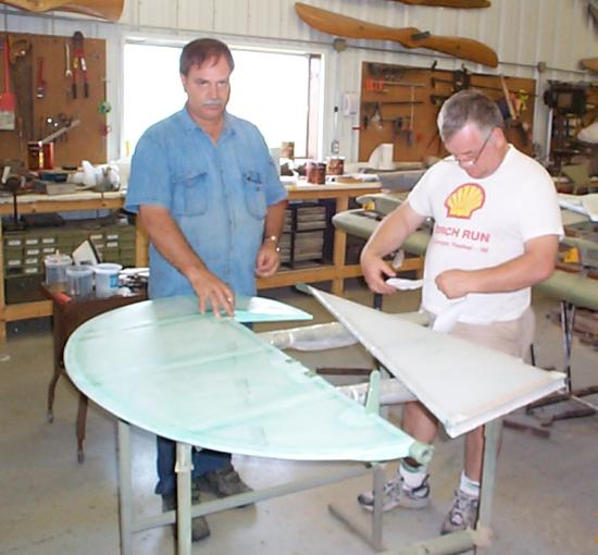 Roger Freeman and Bill Broussard covering the fin and rudder