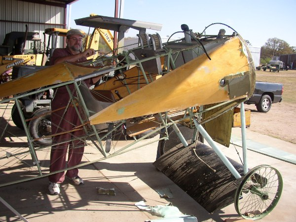 Stripping fabric from the Fokker Dr.I