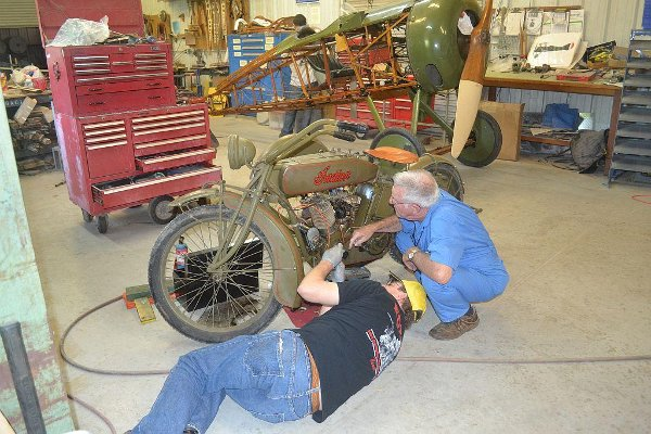 Working on the Indian motorcycle