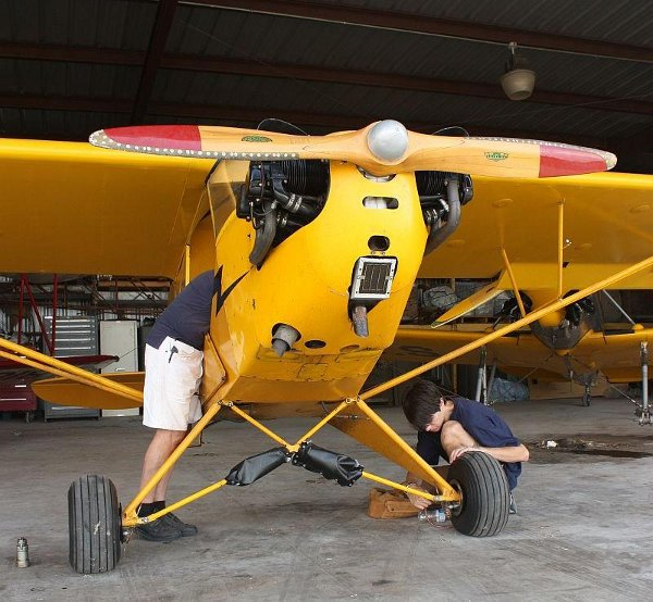 Working on the Piper Cub's side windows