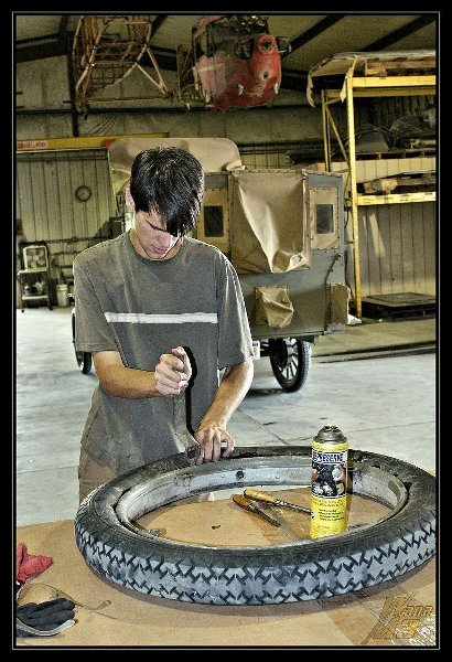 Ian Whitaker working on a Model T tire