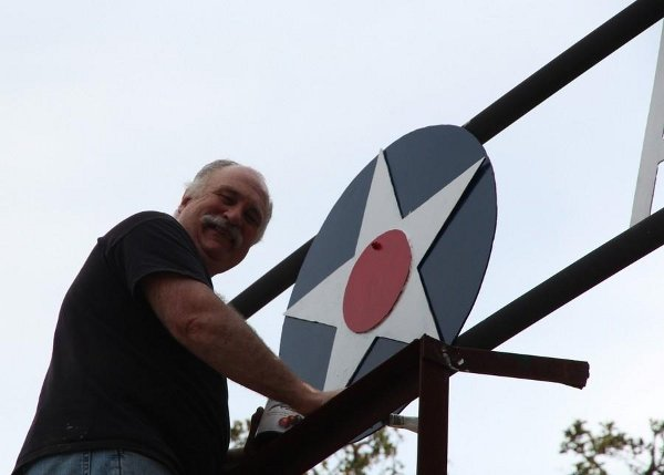 Repainting the entrance sign