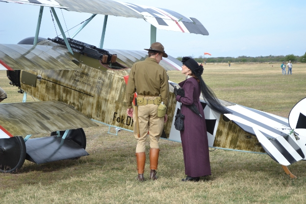 Re-enactors in period garb viewing the Fokker Dr.I